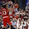 Candyce Bingham passes the ball as Danielle Robinson watches in the second half as the University of Oklahoma plays Louisville at the 2009 NCAA women\'s basketball tournament Final Four in the Scottrade Center in Saint Louis, Missouri on Sunday, April 5, 2009. Photo by Steve Sisney, The Oklahoman
