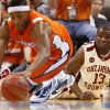 Oklahoma\'s Willie Warren (13) looks on as UTEP\'s Christian Polk (41) recovers a loose ball during the second half of the college basketball game between the University of Oklahoma (OU) and the University of Texas El Paso (UTEP) in the All College Basketball Classic at the Ford Center on Monday, Dec. 21, 2009, in Oklahoma City, Okla. Photo by Chris Landsberger, The Oklahoman ORG XMIT: KOD