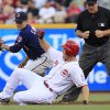 Photo -   Cincinnati Reds' Chris Heisey (28) slides into second base with a double as Minnesota Twins second baseman Jamey Carroll (8) looks for the tag in the third inning of a baseball game, Friday, June 22, 2012 in Cincinnati. Umpire Bob Davidson watches. (AP Photo/Al Behrman)
