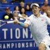 Photo - Kei Nishikori, of Japan, reaches for a return to Michael Russell, of the United States, in the semifnals at the U.S. National Indoor Tennis Championships on Saturday, Feb. 15, 2014, in Memphis, Tenn. (AP Photo/Rogelio V. Solis)
