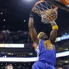 Golden State Warriors\' Jermaine O\'Neal (7) dunks as Phoenix Suns\' Goran Dragic, left, of Slovenia, and Markieff Morris, right, stand near during the first half of an NBA basketball game Saturday, Feb. 8, 2014, in Phoenix. (AP Photo/Ross D. Franklin)