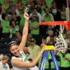 Photo - Notre Dame forward Natalie Achonwa holds a piece of the net after their NCAA women's college basketball tournament regional final game at the Purcell Pavilion in South Bend, Ind Monday March 31, 2014. Notre Dame beat Baylor, 88-69. (AP Photo/Joe Raymond)