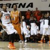 Oklahoma State\'s Marcus Smart (33) reacts in front of Texas\' Isaiah Taylor (1) after a dunk during an NCAA college basketball game between the Oklahoma State Cowboys (OSU) and the University of Texas Longhorns at Gallagher-Iba Arena in Stillwater, Okla., Wednesday, Jan. 8, 2014. Oklahoma State won 87-74. Photo by Bryan Terry, The Oklahoman