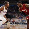 Miami\'s LeBron James (6) looks to get the ball past Oklahoma City\'s Kevin Durant (35) during the NBA basketball game between the Miami Heat and the Oklahoma City Thunder at Chesapeake Energy Arena in Oklahoma City, Sunday, March 25, 2012. Photo by Nate Billings, The Oklahoman