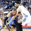 Thunder guard Russell Westbrook loses the ball as he runs into Denver's Wilson Chandler during OKC's loss Monday. AP PHOTO