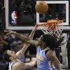 San Antonio Spurs\' Manu Ginobili, left, of Argentina, goes to the basket as Denver Nuggets\' Kenneth Faried (35) defends during the second half of an NBA basketball game, Wednesday, March 27, 2013, in San Antonio. San Antonio won 100-99. (AP Photo/Eric Gay)