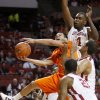 Oklahoma State\'s Cezar Guerrero goes to the basket as Oklahoma\'s Andrew Fitzgerald, top, C.J. Washington, and Cameron Clark defend during the Bedlam men\'s college basketball game between the University of Oklahoma Sooners and the Oklahoma State Cowboys in Norman, Okla., Wednesday, Feb. 22, 2012. Oklahoma won 77-64. Photo by Bryan Terry, The Oklahoman
