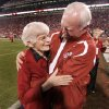 Mary Geynne Mildren, mother of Jack Mildren, and Chuck Fairbanks hug during halftime of the college football game between the University of Oklahoma Sooners (OU) and the University of Nebraska Huskers (NU) at the Gaylord Family -- Oklahoma Memorial Stadium, on Saturday, Nov. 1, 2008, in Norman, Okla. BY STEVE SISNEY, THE OKLAHOMAN