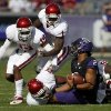 Oklahoma\'s Aaron Colvin (14), Tony Jefferson (1), Frank Shannon, bottom left, and Stacy McGee (92) combine to bring down TCU quarterback Trevone Boykin (2) in the first half of an NCAA college football game Saturday, Dec. 1, 2012, in Fort Worth, Texas. (AP Photo/Tony Gutierrez)