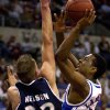 COLLEGE BASKETBALL: KANSAS VS UTAH STATE FIRST ROUND OF THE NCAA TOURNAMENT IN OKLAHOMA CITY, OKLAHOMA, MARCH 20, 2003. Kansas #5 Keith Langford goes up for a shot against Utah\'s #32 Spencer Nelson at the Ford Center Thursday in Oklahoma City. Staff photo by Ty Russell.