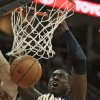 Indiana Pacers\' Roy Hibbert (55) dunks the ball during the first quarter of an NBA basketball game against the Cleveland Cavaliers, Friday, Dec. 21, 2012, in Cleveland. Hibbert scored a team-high 18 points for the Pacers\' 99-89 win. (AP Photo/Tony Dejak)