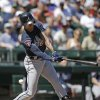 Photo - Atlanta Braves' B.J. Upton swings and misses to strike out against the Seattle Mariners in the third inning of a baseball game Wednesday, Aug. 6, 2014, in Seattle. (AP Photo/Elaine Thompson)