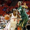 Oklahoma\'s Aaryn Ellenberg (3) drives past Baylor\'s Jordan Madden (3) during a women\'s college basketball game between the University of Oklahoma and Baylor at the Lloyd Noble Center in Norman, Okla., Monday, Feb. 25, 2013. Baylor beat OU, 86-64. Photo by Nate Billings, The Oklahoman