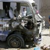 Children inspect a bus destroyed in a car bomb attack in the Shiite stronghold of Sadr City, Baghdad, Iraq, Tuesday, March 19, 2013. A wave of bombings tore through Baghdad on Tuesday, killing and wounding scores of people, police said, highlighting increasing sectarian tensions on the eve of the 10th anniversary of the U.S.-led war. (AP Photo/ Karim Kadim)