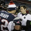Baltimore Ravens quarterback Joe Flacco, right, talks to New England Patriots quarterback Tom Brady following the NFL football AFC Championship football game in Foxborough, Mass., Sunday, Jan. 20, 2013. The Ravens defeated the Patriots 28-13 to advance to Super Bowl XLVII. (AP Photo/Steven Senne)