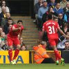 Photo - Liverpool's Luis Suarez, left, celebrates scoring his side's second goal with Raheem Sterling who scored their first, during their English Premier League match against Norwich City at Carrow Road, Norwich, eastern England, Sunday April 20, 2014. (AP Photo/PA, Chris Radburn)  UNITED KINGDOM OUT  NO SALES  NO ARCHIVE