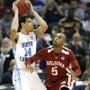 Oklahoma\'s Tony Crocker (5) fouls North Carolina\'s Danny Green (14) during the second half in the Elite Eight game of NCAA Men\'s Basketball Regional between the University of North Carolina and the University of Oklahoma at the FedEx Forum on Sunday, March 29, 2009, in Memphis, Tenn. PHOTO BY CHRIS LANDSBERGER, THE OKLAHOMAN