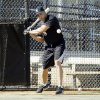 Photo - New York Yankees outfielder Carlos Beltran hits in the batting cage during spring training baseball practice, Monday, Feb. 17, 2014, in Tampa, Fla. (AP Photo/Charlie Neibergall)