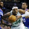 Boston Celtics\' Paul Pierce (34) drives for the basket between Philadelphia 76ers\' Dorell Wright, left, and Lavoy Allen during the second quarter of an NBA basketball game in Boston, Friday, Nov. 9, 2012. (AP Photo/Michael Dwyer)