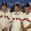 Photo - Retired managers, from left, Tony La Russa, Joe Torre and Bobby Cox gather for a photo after it was announced that they were unanimously elected to the baseball Hall of Fame during MLB winter meetings in Lake Buena Vista, Fla., Monday, Dec. 9, 2013.(AP Photo/John Raoux)