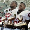 Gerald McCoy, defensive lineman of the game, and Ryan Broyles, player of the game hold a collection of trophies after their 31-27 victory at the Brut Sun Bowl college football game between the University of Oklahoma Sooners (OU) and the Stanford University Cardinal on Thursday, Dec. 31, 2009, in El Paso, Tex. Photo by Steve Sisney, The Oklahoman