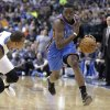 Photo - Oklahoma City Thunder guard Reggie Jackson, right, drives against Dallas Mavericks guard Monta Ellis during the first half of an NBA basketball game Tuesday, March 25, 2014, in Dallas. (AP Photo/LM Otero)