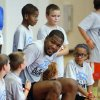 Photo - Kevin Durant fits into a team picture with campers during his basketball camp on Thursday, Aug. 7, 2014 in Moore, Okla. Photo by Steve Sisney, The Oklahoman