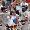 Photo - Boston Red Sox David Ortiz, right, celebrates his three run homer with teammate Xander Bogaerts in the fifth inning of a baseball game against the Atlanta Braves in Atlanta, Monday May 26, 2014. (AP Photo/Atlanta Journal-Constitution, Brant Sanderlin )  MARIETTA DAILY OUT; GWINNETT DAILY POST OUT; LOCAL TV OUT; WXIA-TV OUT; WGCL-TV OUT   .