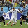 Photo - England's Wayne Rooney, second left, takes on the Uruguay defense during the group D World Cup soccer match between Uruguay and England at the Itaquerao Stadium in Sao Paulo, Brazil, Thursday, June 19, 2014.  (AP Photo/Matt Dunham)