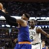 New York Knicks\' Carmelo Anthony grabs a pass over Boston Celtics\' Jeff Green (8) during the second quarter of Game 3 of a first round NBA basketball playoff series, Friday, April 26, 2013, in Boston. (AP Photo/Winslow Townson)