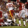 Oklahoma\'s Ronnell Lewis (55) grabs his knee as he lies on the ground after being injured on kick coverage during the first half of the college football game between the University of Oklahoma Sooners (OU) and the Iowa State Cyclones (ISU) at the Glaylord Family-Oklahoma Memorial Stadium on Saturday, Oct. 16, 2010, in Norman, Okla. Photo by Chris Landsberger, The Oklahoman