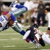Chicago Bears cornerback D.J. Moore (30) tackles Dallas Cowboys tight end Jason Witten (82) during the second half of an NFL football game, Monday, Oct. 1, 2012, in Arlington, Texas. (AP Photo/Sharon Ellman)
