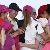 Karrie Webb, third from left, of Australia, smiles as she gets hugs from LPGA-USGA Girls Golf members, after Webb won the LPGA Founders Cup golf tournament on Sunday, March 23, 2014, in Phoenix. (AP Photo/Ross D. Franklin)