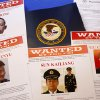 Photo - Press materials are displayed on a table of the Justice Department in Washington, Monday, May 19, 2014, before Attorney General Eric Holder was to speak at a news conference. Holder was announcing that a U.S. grand jury has charged five Chinese hackers with economic espionage and trade secret theft, the first-of-its-kind criminal charges against Chinese military officials in an international cyber-espionage case. (AP Photo/Charles Dharapak)