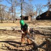 Team Leader Carol Schneider uses a chainsaw to clear branches from an area in Lake Murray State Park. PHOTO BY DANIELLE LANDRY PROVIDED.