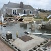 This Tuesday, Oct. 30, 2012 photo shows a house, background, pushed off its foundation, foreground, by superstorm Sandy in East Haven, Conn. (AP Photo/Jessica Hill) ORG XMIT: CTJH109