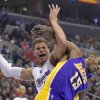 Los Angeles Clippers forward Blake Griffin, left, and Los Angeles Lakers forward Metta World Peace tangle during the first half of their NBA basketball game, Friday, Jan. 4, 2013, in Los Angeles. (AP Photo/Mark J. Terrill)