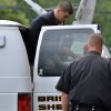 Former New England Patriot football player Aaron Hernandez, is lead from a sheriff\'s van into a courthouse in Attleboro, Mass., Thursday, Aug. 22, 2013. Hernandez was indicted on first-degree murder and weapons charges in the death of a friend whose bullet-riddled body was found in an industrial park about a mile from the ex-player\'s home. (AP Photo/Josh Reynolds)
