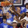 Oklahoma City\'s Serge Ibaka (9) dunks over Miami\'s Dwyane Wade (3) during Game 1 of the NBA Finals between the Oklahoma City Thunder and the Miami Heat at Chesapeake Energy Arena in Oklahoma City, Tuesday, June 12, 2012. Photo by Nate Billings, The Oklahoman