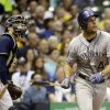 Milwaukee Brewers catcher Jonathan Lucroy watches as Colorado Rockies\' Ryan Wheeler hits a grand slam during the fourth inning of a baseball game Thursday, June 26, 2014, in Milwaukee. (AP Photo/Morry Gash)