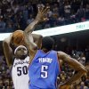Oklahoma City\'s Kendrick Perkins (5) goes up to block the final shot in regulation by Memphis\' Zach Randolph (50) during Game 4 of the second-round NBA basketball playoff series between the Oklahoma City Thunder and the Memphis Grizzlies at FedExForum in Memphis, Tenn., Monday, May 13, 2013. Memphis won 103-97 in overtime. Photo by Nate Billings, The Oklahoman