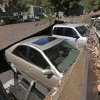 A carport is seen collapsed onto vehicles Sunday, Aug. 24, 2014, in Napa, Calif. Officials say an earthquake with a preliminary magnitude of 6.0 has been reported in California\'s northern San Francisco Bay area. (AP Photo/Ben Margot)