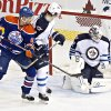 Photo - Winnipeg Jets goalie Edward Pasquale (32) makes a save as Jacob Trouba (3) and Edmonton Oilers Jesse Joensuu (6) watch during the second period of an NHL hockey preseason game Monday, Sept. 23, 2013, in Edmonton, Alberta.. (AP Photo/The Canadian Press, Jason Franson)