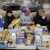 Members of the Mid-Island Little League organize donated food stuffs at an impromptu aid station in Staten Island, New York, Friday, Nov. 2, 2012. Sandy, the storm that made landfall Monday, caused multiple fatalities, halted mass transit and cut power to more than 6 million homes and businesses. (AP Photo/Seth Wenig) ORG XMIT: NYSW127