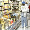 Photo - A customer shops for juice at a Warehouse Market in Tulsa.  Tulsa World Archives  SHERRY BROWN