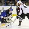 St. Louis Blues goalie Brian Elliot (1) blocks a shot by Colorado Avalanche\'s Greg Zanon (4) in the first period of an NHL hockey game Tuesday, April 23, 2013, in St. Louis. (AP Photo/Bill Boyce)