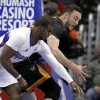 Los Angeles Clippers guard Chris Paul, left, steals the ball away from Phoenix Suns center Miles Plumlee, right, during the first half of an NBA basketball game Monday, March 10, 2014, in Los Angeles. (AP Photo/Alex Gallardo)