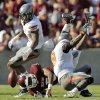 Texas A&M\'s Kenric McNeal (5) fumbles the ball after being upended by Oklahoma State\'s Daytawion Lowe (8) in front of Justin Gilbert (4) in the third quarter Saturday. The fumble and recovery turned the tide of the game, leading OSU to a 30-29 win in College Station, Texas. Photo by Nate Billings, The Oklahoman