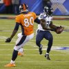 Photo - Seattle Seahawks strong safety Kam Chancellor (31) intercepts a pass intended for Denver Broncos tight end Julius Thomas (80) during the first half of the NFL Super Bowl XLVIII football game Sunday, Feb. 2, 2014, in East Rutherford, N.J. (AP Photo/Matt York)