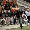 The Oklahoma State sideline cheers as Oklahoma State\'s James Thomas (22) returns a tipped pass during a college football game between the Oklahoma State University Cowboys (OSU) and the Kansas State University Wildcats (KSU) at Boone Pickens Stadium in Stillwater, Okla., Saturday, Nov. 5, 2011. Photo by Sarah Phipps, The Oklahoman